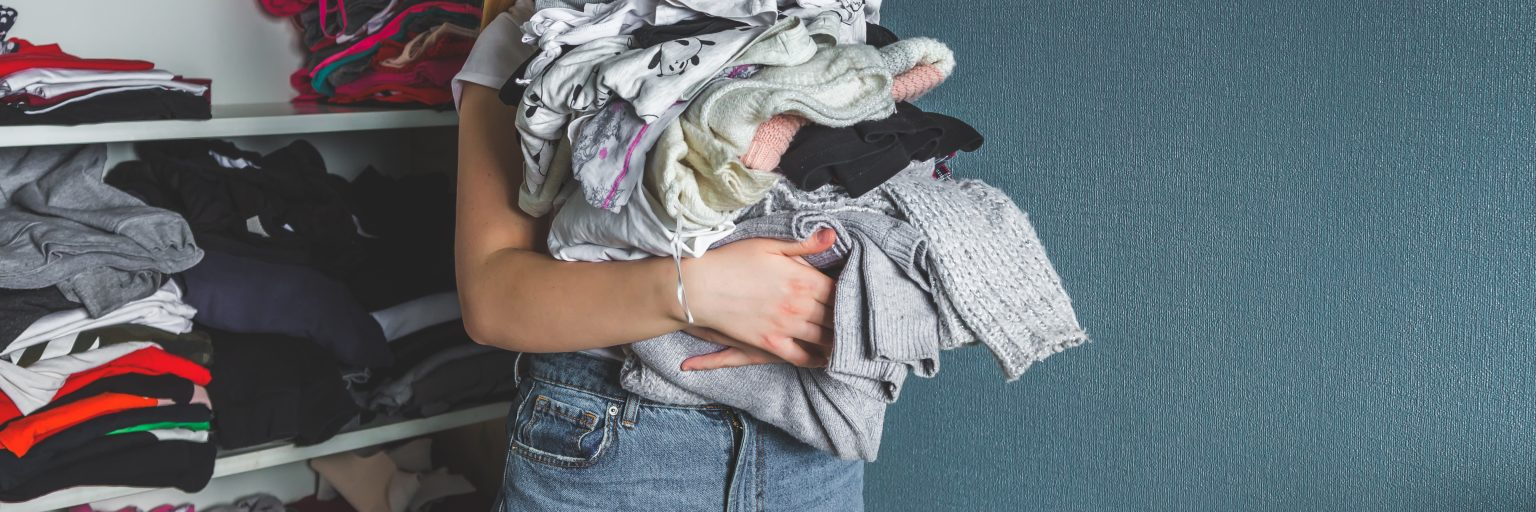 Holding Secondhand Clothing